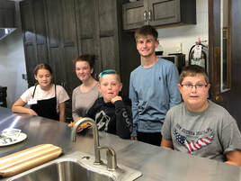 Some Epiphany youth in the new kitchen